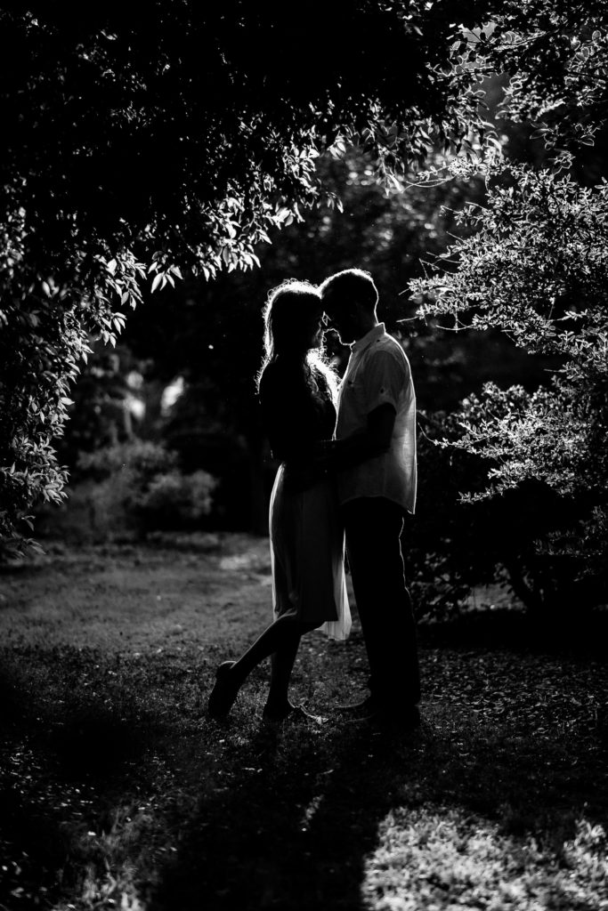 Black and white portrait of a couple in a garden