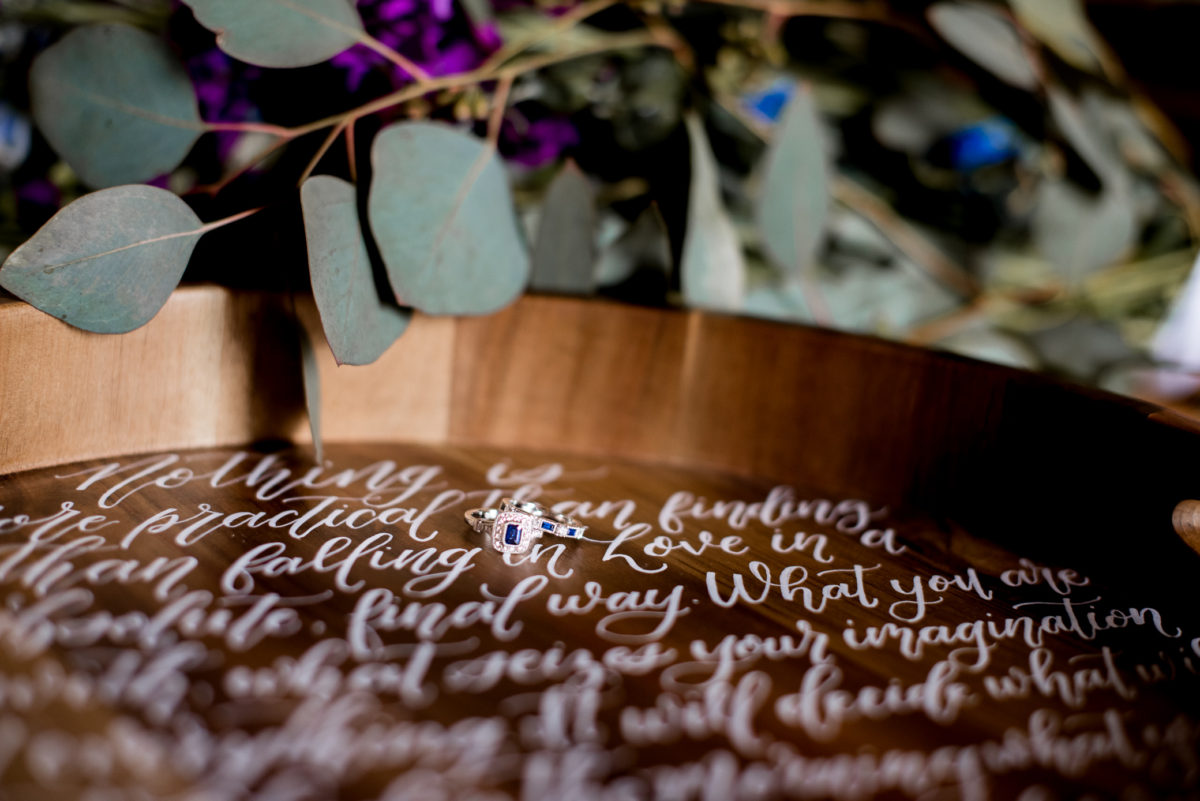 Jessica Patricia Photography hand lettered calligraphy tray with flowers and engagement ring