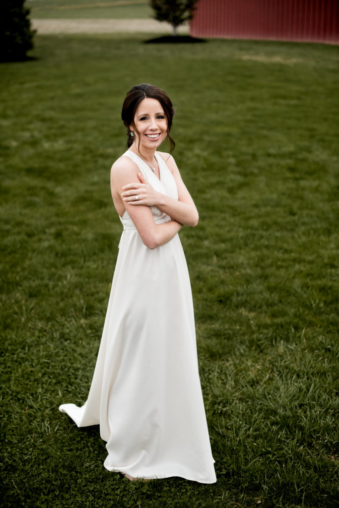 Jessica Patricia Photography Barn Bridal Portrait on the grass by Red Barn