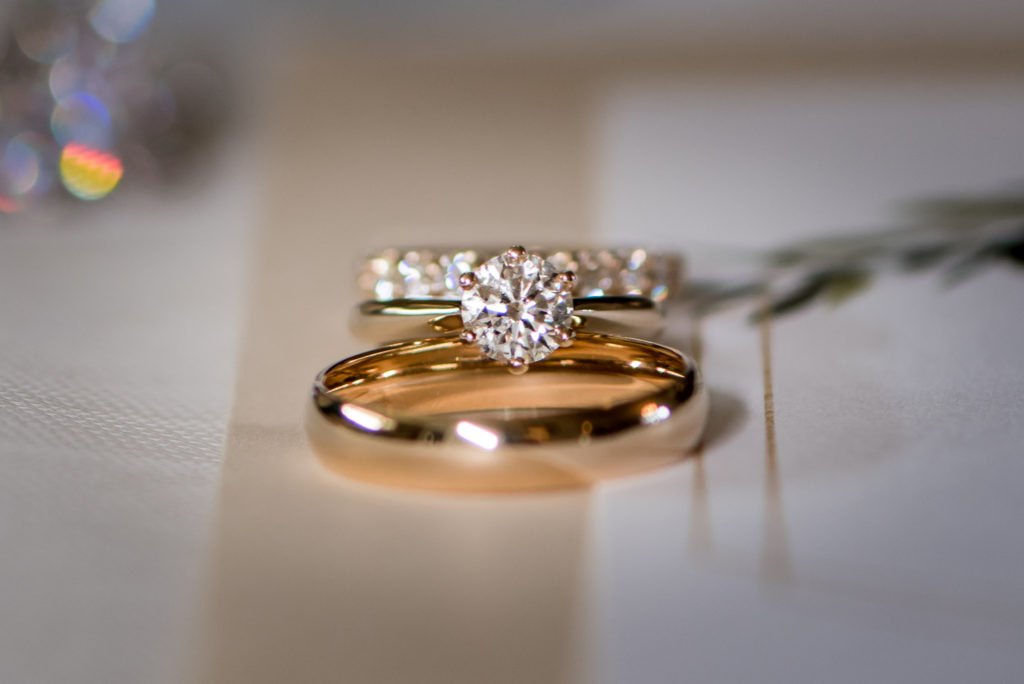 Jessica Patricia Photography Yellow Gold wedding band set with infinity band and solitaire engagement ring
