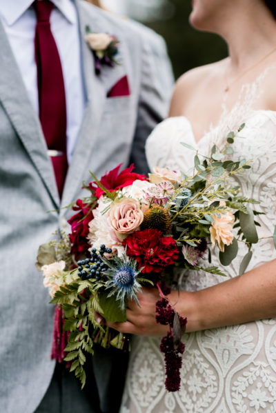 Jessica Patricia Photography Bride and Groom with fall colored Bouquet and burgundy Details