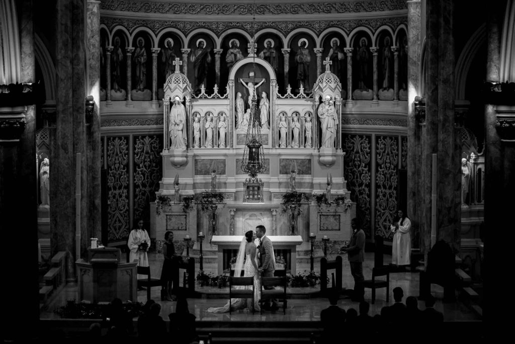 black and white image of first kiss and catholic church with grand alter
