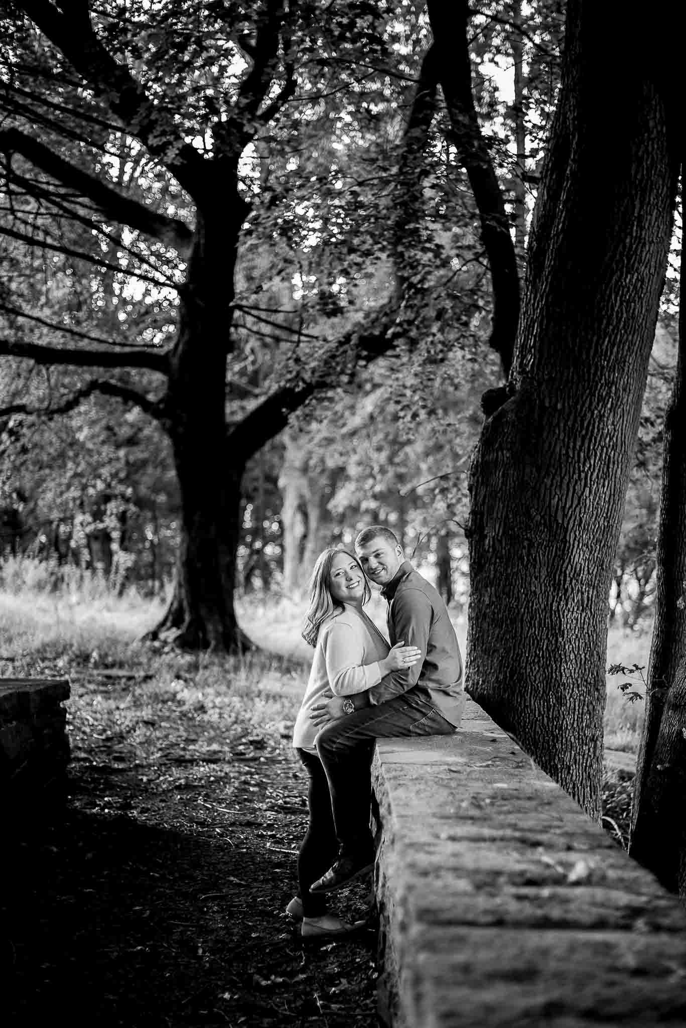 black and white wooded engagement session on moss covered bridge