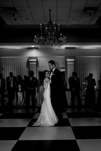 Black and White first dance under chandelier