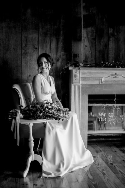 Bridal portrait of sitting bride with mantle and chandelier