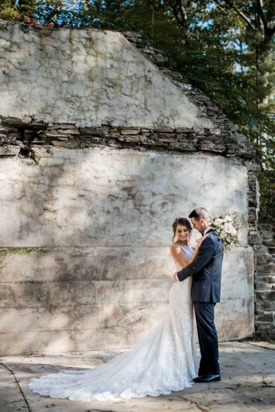 Wedding portrait by concrete wall with sunspots_Jessica Patricia Photography